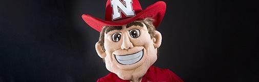 Profile view of mascot Herbie Husker